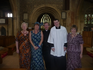 Members of St James visited Ho in 2012 and the ladies have the costume to prove it!